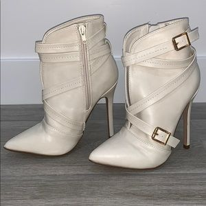 Cream strappy booties with slit in the front